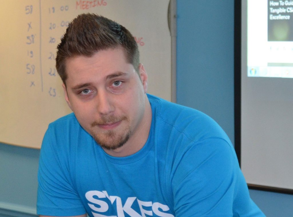 His Search for Opportunity Led Him to SYKES